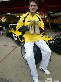 Giancarlo Fisichella presents his Puma Racing shoes