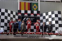 The podium: race winner Michael Schumacher with Fernando Alonso and Rubens Barrichello