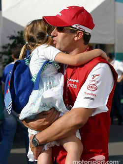 Olivier Panis arrives at the track with his daughter