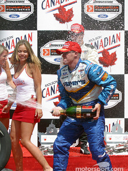 Paul Tracy sprays champagne