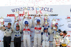 Class winners podium: overall and LMP900 winners Frank Biela and Marco Werner with LMP675 winners Chris Dyson and Andy Wallace, GT winners Timo Bernhard and Jorg Bergmeister and GTS winners Ron Fellows and Johnny O'Connell