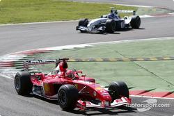 Michael Schumacher leads Juan Pablo Montoya