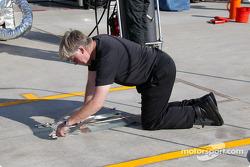McLaren team member prepares pitlane