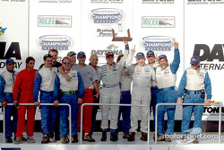 Race winners Terry Borcheller and Forest Barber celebrate with Bell Motorsports team members