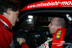 Miki Biasion talks with Mitsubishi Motors Motor Sports Team Director Dominique Serieys