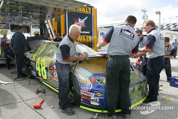 Hendrick Motorsports crew members prepare the car