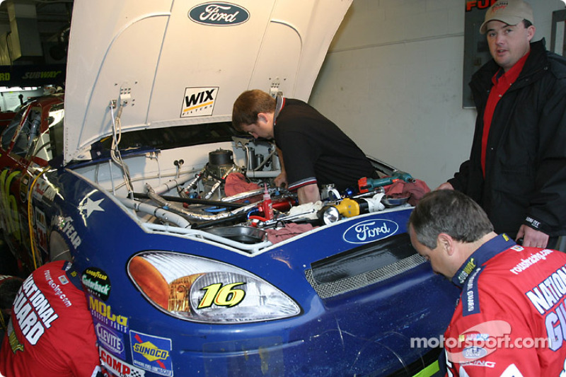 Roush Racing garage area: the National Guard crew still work on engine change on Greg Biffle's car