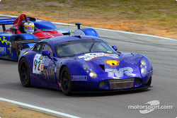 Female racer Amanda Stretton of England steers the #92 TVR as Jon Field overtakes her in the Intersport Lola B160-Judd
