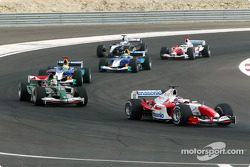 Olivier Panis ahead of Mark Webber