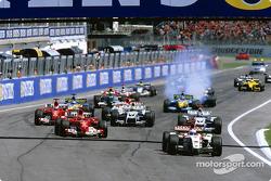 Start: Jenson Button takes the lead ahead of Michael Schumacher
