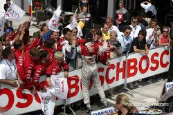 Race winner Mattias Ekström celebrates with team