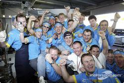 Jarno Trulli celebrates with his team