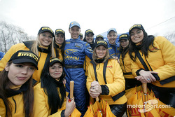 Petter Solberg and Mikko Hirvonen with the charming Pirelli girls
