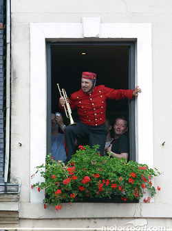 Marching band member at window