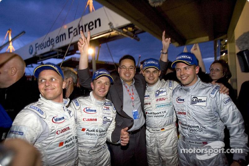 Audi Sport UK Team Veloqx celebrate victory: Johnny Herbert, Allan McNish, Sam Li, Pierre Kaffer and Jamie Davies