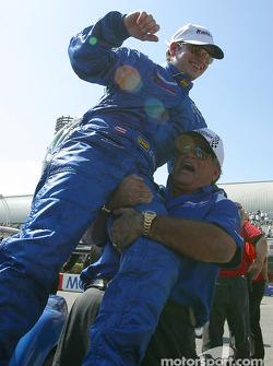 Race winner Jorge Diaz Jr. celebrates with his dad