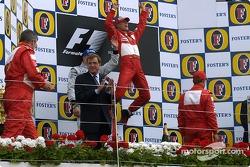 Podium: race winner Michael Schumacher with Kimi Raikkonen and Rubens Barrichello