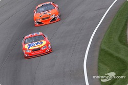 Robby Gordon chases Ricky Craven into turn 4