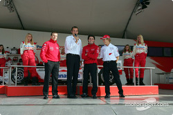 Olivier Panis, Ricardo Zonta and Ryan Briscoe at Toyota merchandising booth