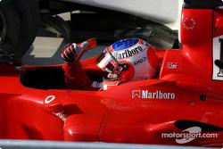Race winner Rubens Barrichello arrives in Parc Fermé