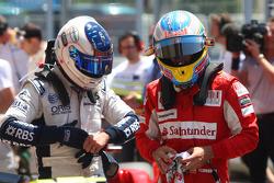 Rubens Barrichello, Williams F1 Team and Fernando Alonso, Scuderia Ferrari