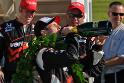 Will Power takes a drink of champagne