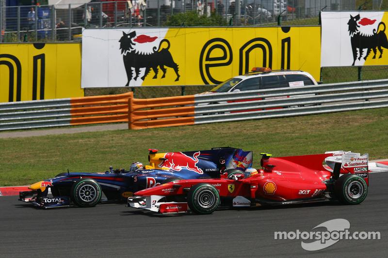 Sebastian Vettel, Red Bull Racing en Fernando Alonso, Scuderia Ferrari bij de start