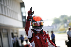 Alexander Rossi celebrates victory in parc ferme