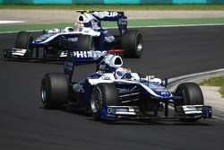 Rubens Barrichello, Williams F1 Team leads Nico Hulkenberg, Williams F1 Team