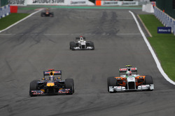 Sebastian Vettel, Red Bull Racing and Vitantonio Liuzzi, Force India F1 Team