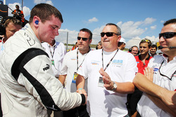 2010 Formula Two Champion Dean Stoneman is congratulated by his father Colin Stoneman