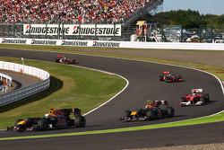 Sebastian Vettel, Red Bull Racing leads Mark Webber, Red Bull Racing and Fernando Alonso, Scuderia Ferrari