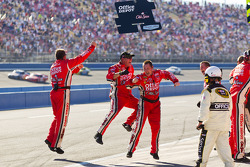Stewart-Haas Racing Chevrolet crew members celebrate the victory of Tony Stewart