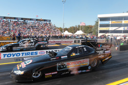 Phil Burkhart Jr. competes against Matt Hagan during round 1