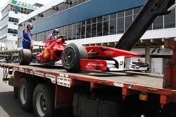 The car of Fernando Alonso, Scuderia Ferrari, returns to the pits