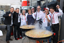 LCR Honda MotoGP team members celebrate with a Valencian paella
