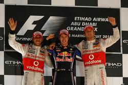 Podium: race winner and 2010 Formula One World Champion Sebastian Vettel, Red Bull Racing, second place Lewis Hamilton, McLaren Mercedes, third place Jenson Button, McLaren Mercedes