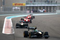 Heikki Kovalainen, Lotus F1 Team leads Jarno Trulli, Lotus F1 Team