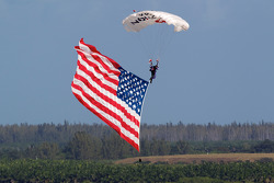 Sky divers bring the flags