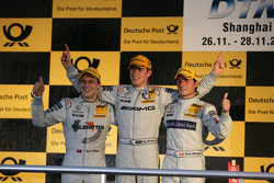 Championship podium: DTM 2010 champion Paul di Resta, Team HWA AMG Mercedes, second place Gary Paffett, Team HWA AMG Mercedes, third place Bruno Spengler, Team HWA AMG Mercedes