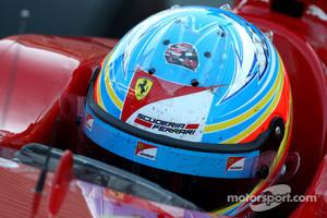 Fernando Alonso, Scuderia Ferrari with a sticker of Robert Kubica, Lotus Renault GP helmet