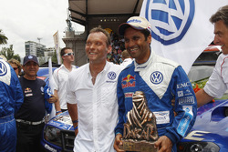 Car category winner Nasser Al Attiyah celebrates with Kris Nissen