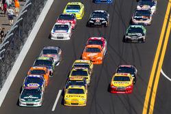 Dale Earnhardt Jr., Hendrick Motorsports Chevrolet, Clint Bowyer, Richard Childress Racing Chevrolet and Kurt Busch, Penske Racing Dodge lead a group of cars