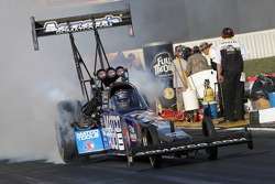 Antron Brown doing a burnout in his Matco Tools Top Fuel Dragster
