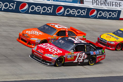 Tony Stewart, Stewart-Haas Racing Chevrolet and Joey Logano, Joe Gibbs Racing Toyota