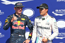(L to R): Max Verstappen, Red Bull Racing celebrates his second position in qualifying parc ferme with pole sitter Nico Rosberg, Mercedes AMG F1