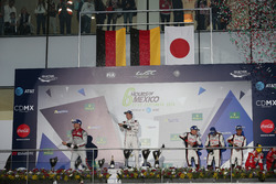 The podium (L to R): Andre Lotterer, #07 Audi Sport Team Joest Audi R18; Brendon Hartley, #01 Porsche Team Porsche 919 Hybrid;  Mike Conway, Stephane Sarrazin, Kamui Kobayashi, #06 Toyota Gazoo Racing Toyota TS050 Hybrid