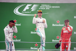 The podium (L to R): second place Lewis Hamilton, Mercedes AMG F1; Race winner Nico Rosberg, Mercedes AMG F1; third place Sebastian Vettel, Ferrari