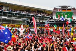 (L to R): Sebastian Vettel, Ferrari and race winner Nico Rosberg, Mercedes AMG F1 celebrate on the podium