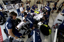 The team work on the car of Valtteri Bottas, Williams FW38 Mercedes, in the garage